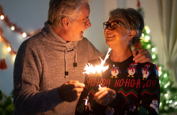 Old couples holding a fireworks