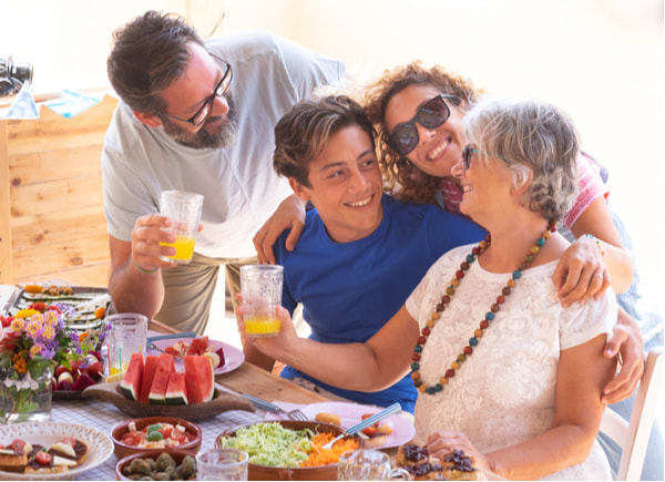 Cheerful family with food on the table
