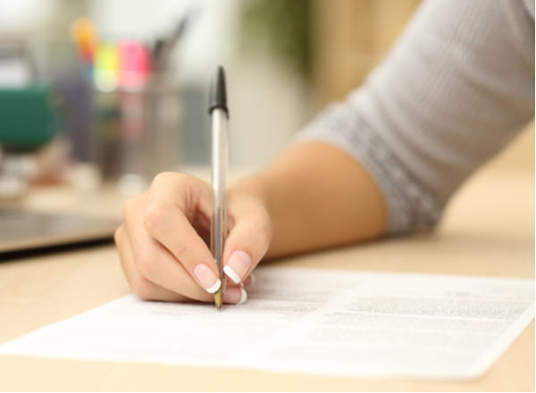 Close up of a woman hand writing