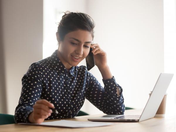Female employee talk on smartphone