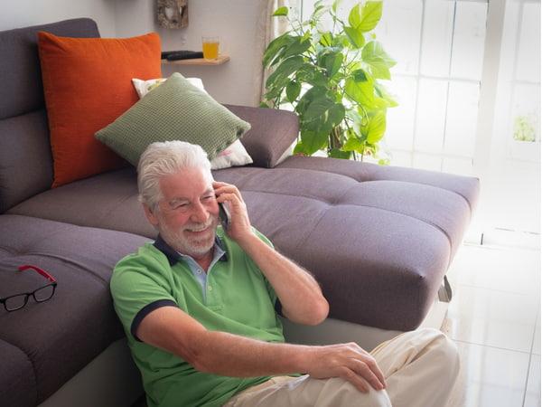 Smiling senior man talking at mobile phone